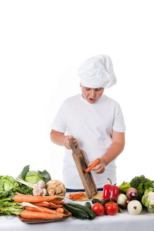 astonished young cook grating carrots Stock Photo