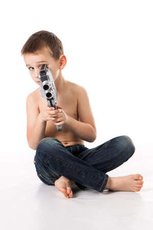 Caucasian boy plays to shoot at the old camera.