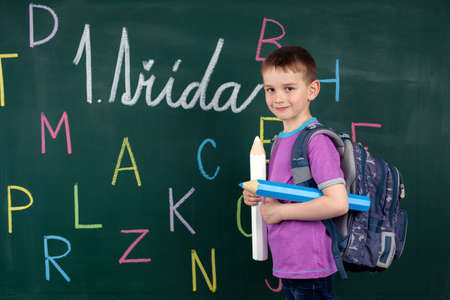 The boy goes to the first class at the school board Stock Photo