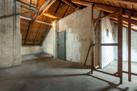 Empty old rustic attic with door.