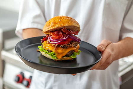 Close-up of home made tasty burgers on plate in restaurant.