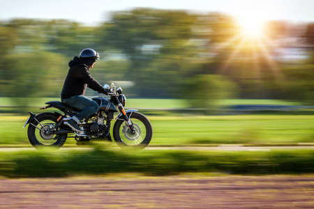 Riding motorcycle pan technic used. copyspace for your individual text. Stock Photo