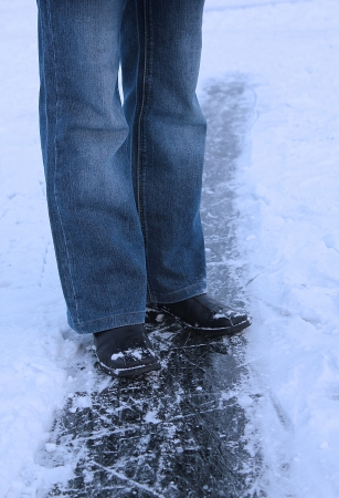 natural ice pastime: legs of a girl on winter ice