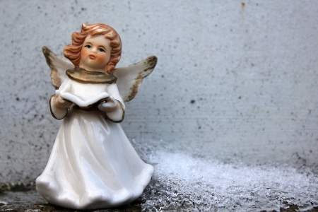 beautiful angel and ice in winter cemetery Stock Photo - 17305751