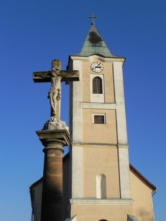 catholic church tower and cross in beautiful sunshine photo