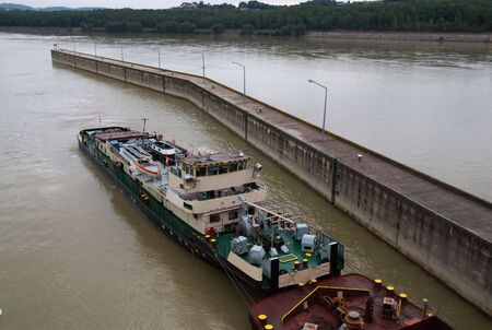Tugboat with coal barge, Danube River, Austria