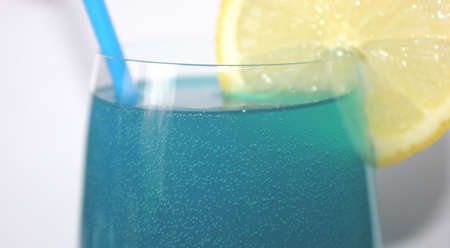 blue cocktail with a lemon and a tube Stock Photo - 13439826