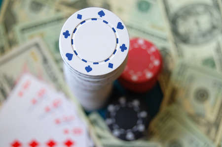 A stack of poker chips with money