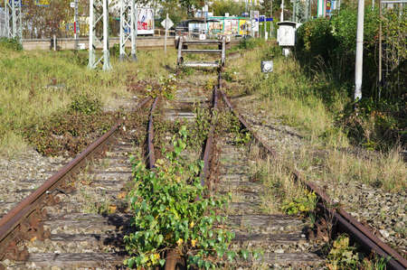 Old abandoned  rusty railway tracks with grass overgrown