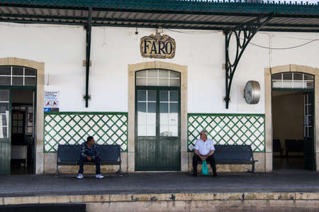 FARO, PORTUGAL - JUNE 1, 2017: Two man waiting in front of Faro t Sajtókép