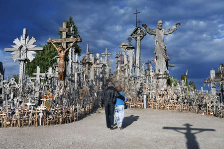 tribute: People pay tribute to the dead at the Hill of Crosses Stock Photo