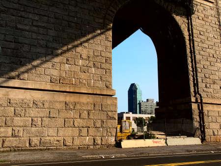 venal: View of a skyscraper under the bridge