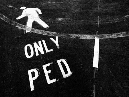 and only: only pedestrian on asphalt