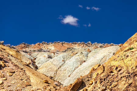 rocky mountains in the desert on a sunny day with blue sky and clouds in the USA in utah