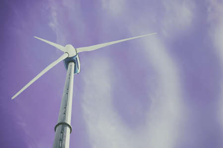 angle view of a wind turbine with blue sky background