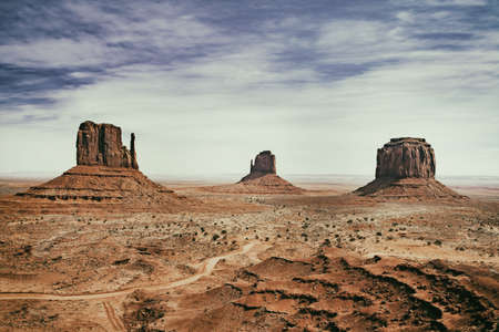 panoramic photo of the Monument Valley Park in Arizona in USA with vintage effect
