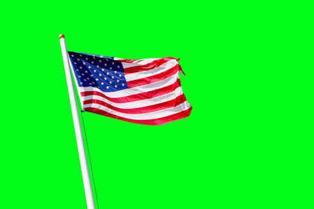 american flag waving on the beam on a green background Stock Photo