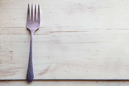 old forks on a green wooden table, Victorian era in the United States of the old westerns