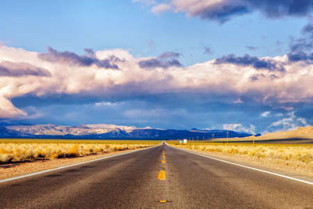 road leading to the death valley national park in Nevada in the United States in the morning during sunrise