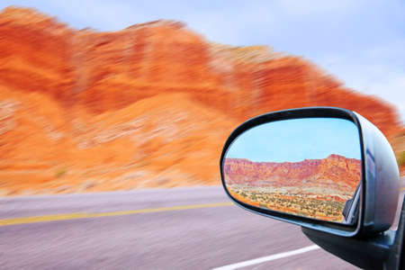 looking back in the cars rearview mirror the Capitol Reef Rocky Mountains near escalante utah on route 12 in the united states