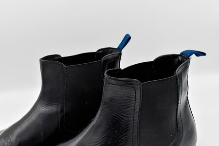 close up of a pair of black mens leather chelsea boots isolated on white background Stock Photo