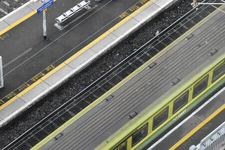 Dublin, Ireland - January 15, 2020: High view of a DART train pulling into grand canal dock station