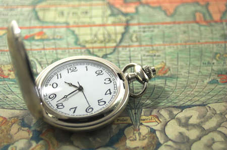 timezone: old pocket watch on a map Stock Photo