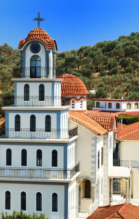 The Greek Orthodox monastery in Mitilinii, Lesvos, which is being rebuilt or renovated.vivid summer colours Stock Photo - 581905