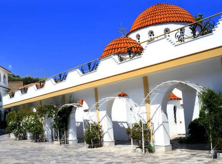 monastic: The Greek Orthodox monastery in Mitilinii, Lesvos, which is being rebuilt or renovated.vivid summer colours