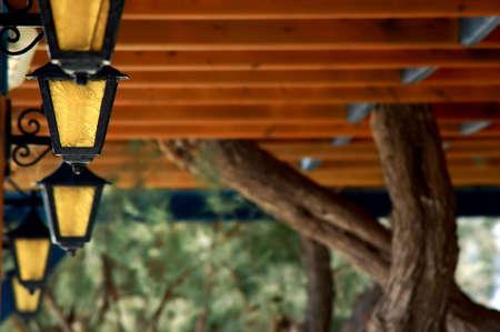 hedging: greek restaurant lighting yellow glass and black metal Stock Photo