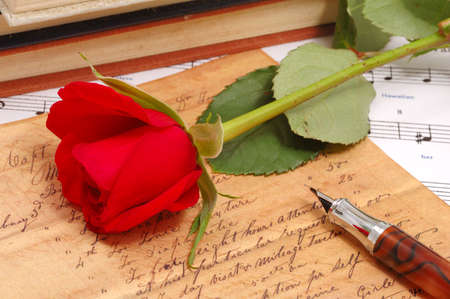cherish: red silky rose with vintage pen and letter