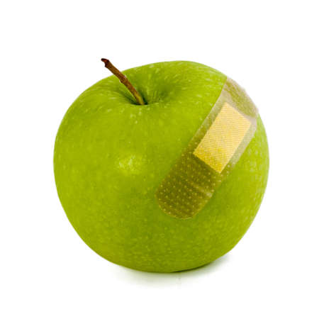 affixed: Green Apple stickers affixed bleeding isolated on white