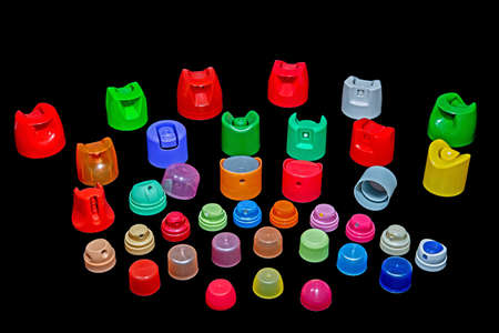 silicone gun: colourful nozzles isolated in the black Stock Photo