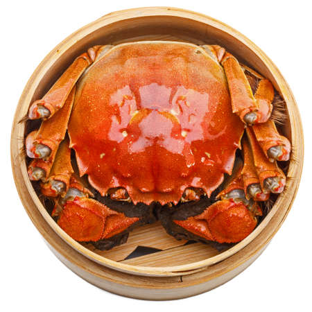 crab meat: Hairy crabs in Bamboo steamer Isolated on white background Stock Photo