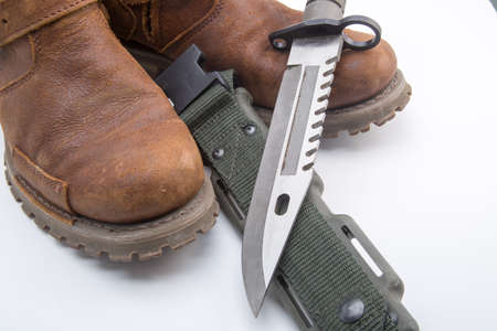 Dark green of military knife in pocket isolated white photo