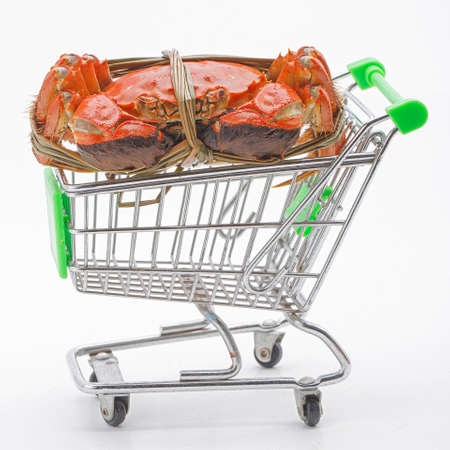 Hairy crabs on the shopping cart isolated in white background photo
