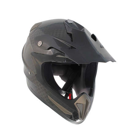 Motocross motorcycle helmet isolated on white background, black, shiny carbon fiber. photo