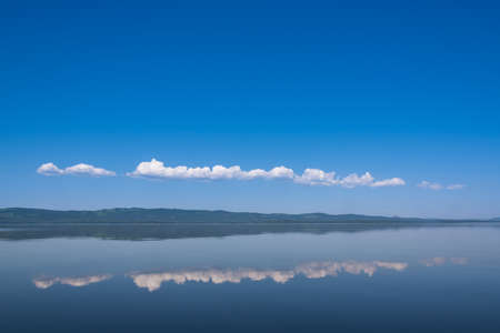 colore: A beautiful panorama shot over a deep blue lake and sky