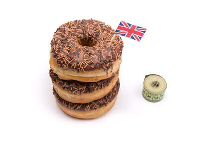 waist deep: Stack of Chocolate Iced Donuts with British Flag and Tape Measure