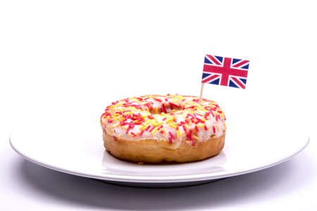 waist deep: Single White Iced Donut with British Flag Stock Photo