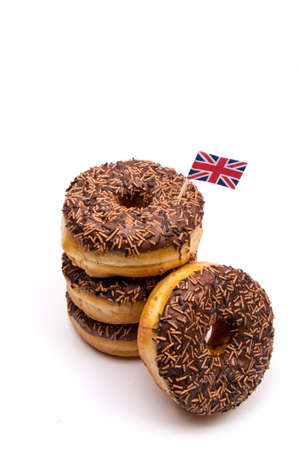 waist deep: Stack of Cocolate Donuts With British Flag Stock Photo