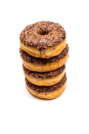 waist deep: Stack of Four Chocolate Donuts Stock Photo