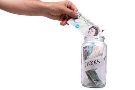 monies: Saving Up To Pay Taxes Stock Photo
