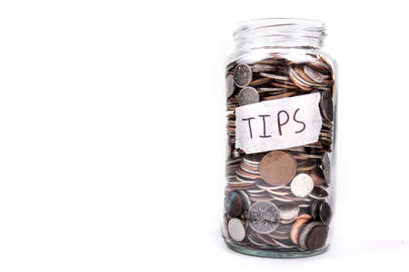 monies: Full Tips Jar Stock Photo