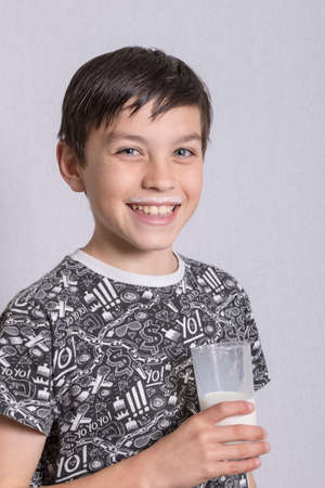 10 to 12 years old: Young Boy With Milk On His Top Lip Stock Photo