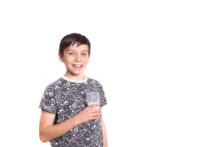 boy 12 year old: Young Boy With Milk On His Top Lip Stock Photo