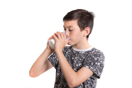 10 to 12 years old: Young Boy Drinking Milk