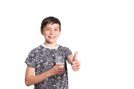 10 to 12 years old: Young Boy With Milk On His Top Lip Giving Thumbs Up Stock Photo