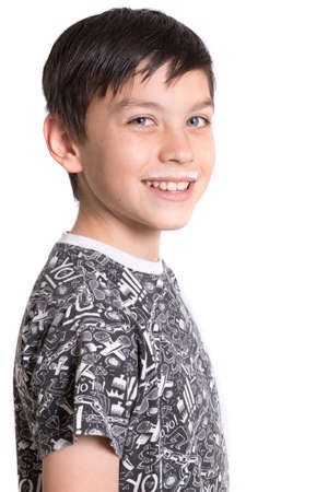 7 year old boys: Young Boy With Milk On His Top Lip Stock Photo