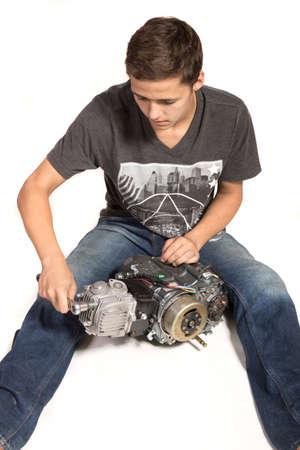 fixing: Teenage Boy Fixing An Engine
